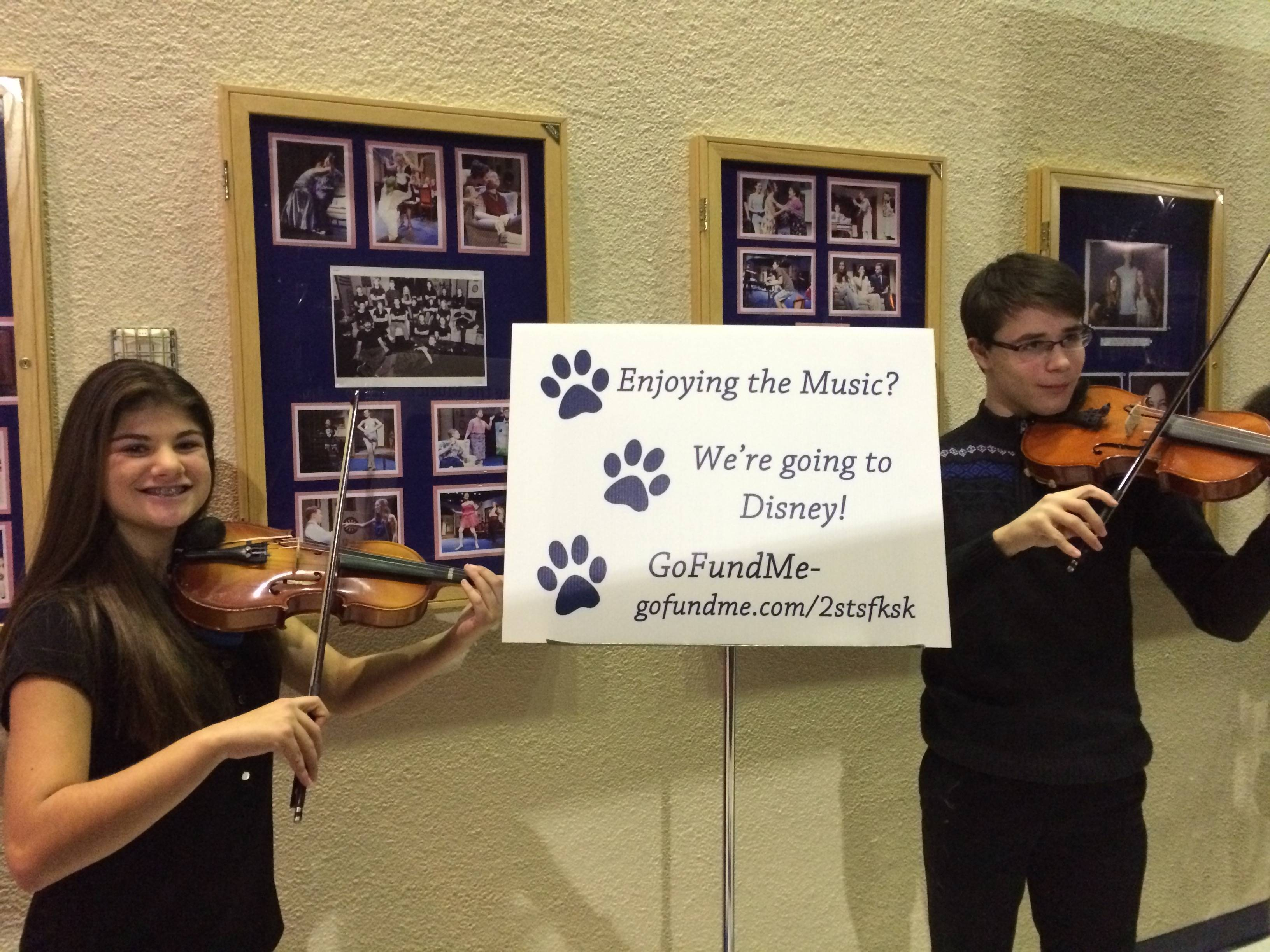 9a1a3a96f1ef5f2ef164_CHS_violinists_welcome_Lafayette_5th_grade_concert_goers__with_a_reminder_to__gufundme__for_the_CHS_Music_department_s_upcoming_trip_to_Disney.jpg