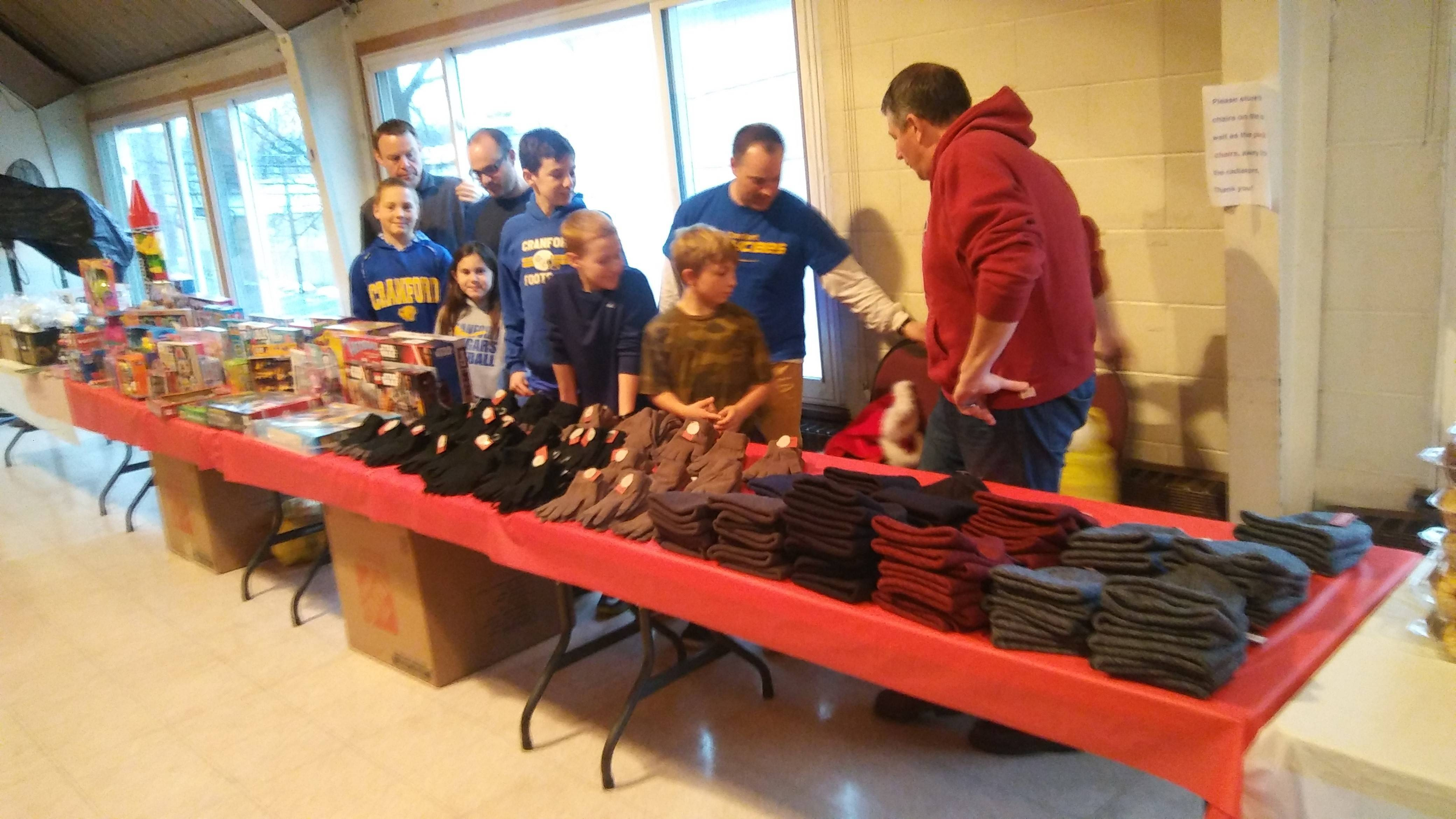 acc61da2a4516c025671_The_Cranford_Jaycees_organizing_the_donated_goods.jpg