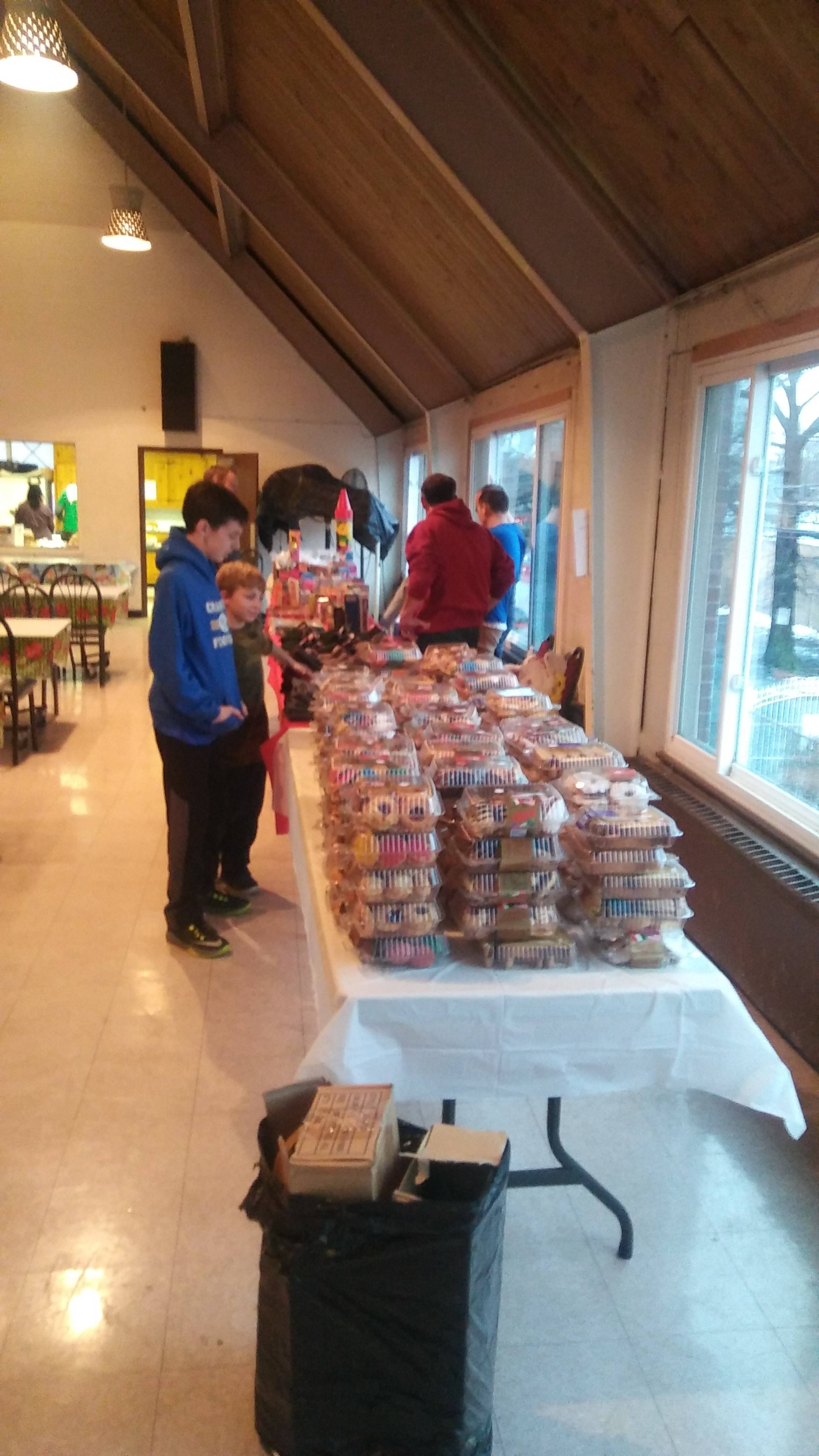 b07f33096486e874f0cc_Volunteers_admiring_the_cookies_donated_by_SuperFresh__formally_The_Food_Emporium.jpg