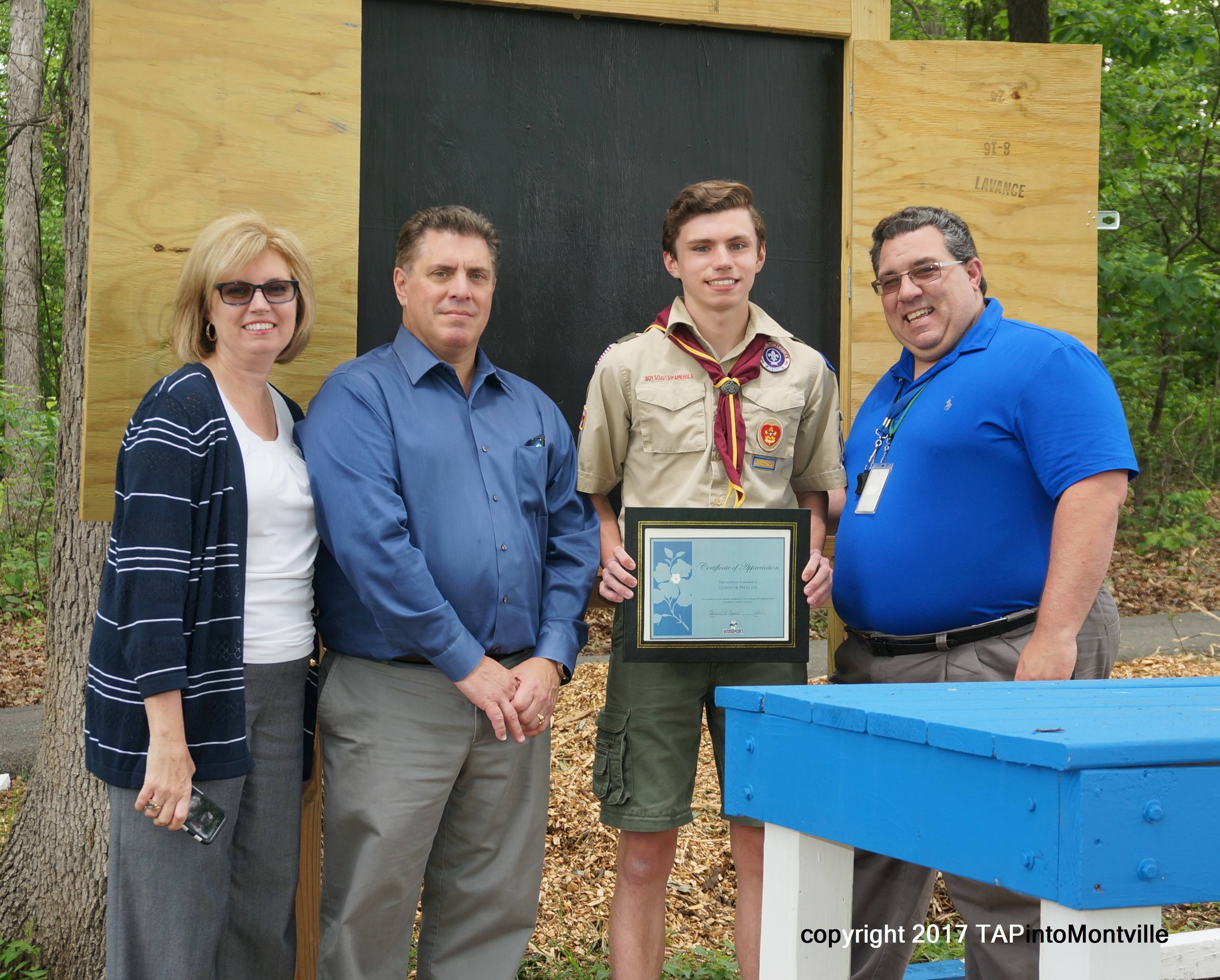 beb5973605b99267870b_a_Parents_Doreen_and_Patrick_Phalen__Scout_Conner_Phalen__and_Woodmont_Principal_Dominic_Esposito.jpg