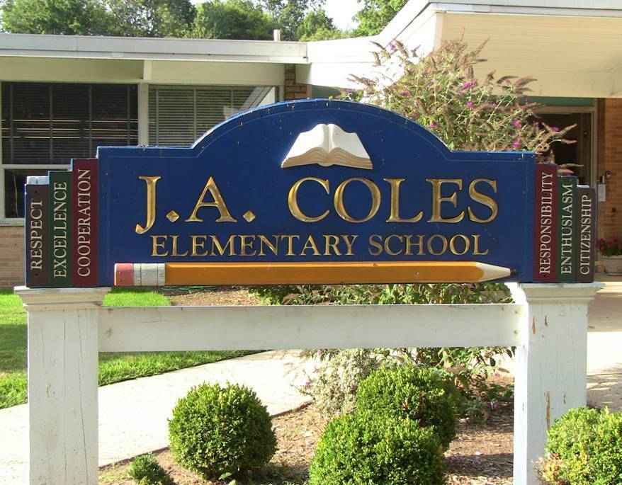 c3930693456a862df139_Coles_School_sign.jpg