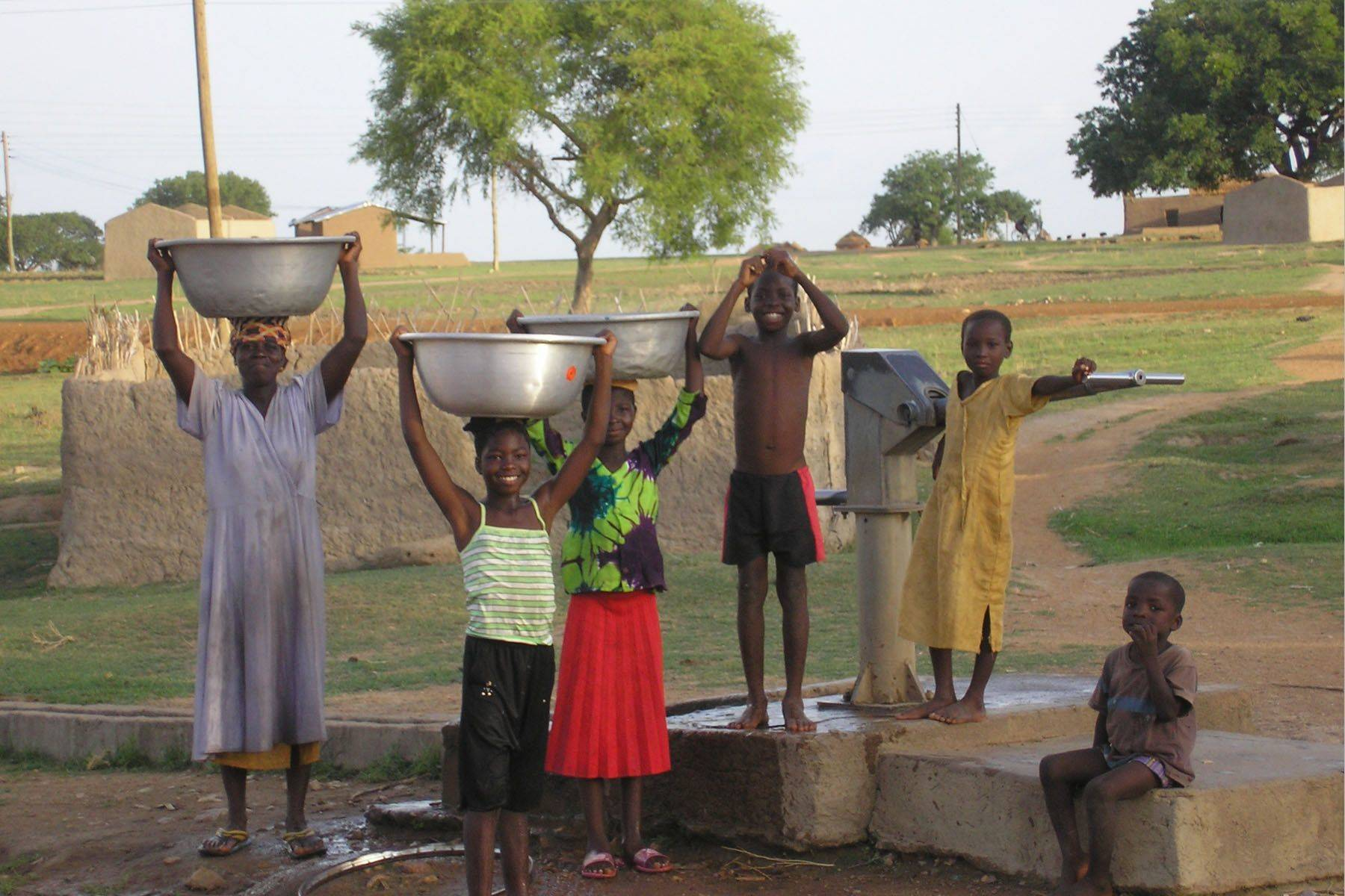 c852124cfa83c5dcb7b7_Outreach_-_Clean_water_-_kids-and-well_in_Ghana__Harvey_Wang_ERD__.original.jpg