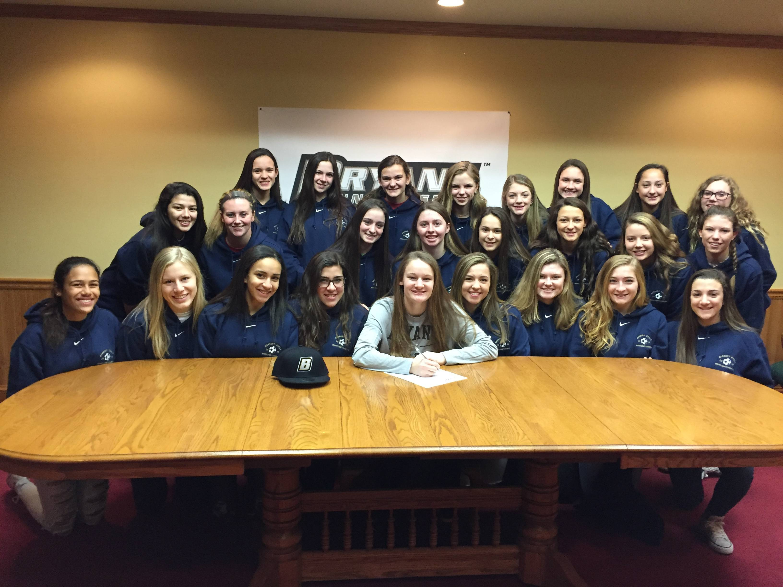 c88a476fe59a8352ea77_Irwin_Signs_Intent_with_Morris_Cty_Champs.JPG