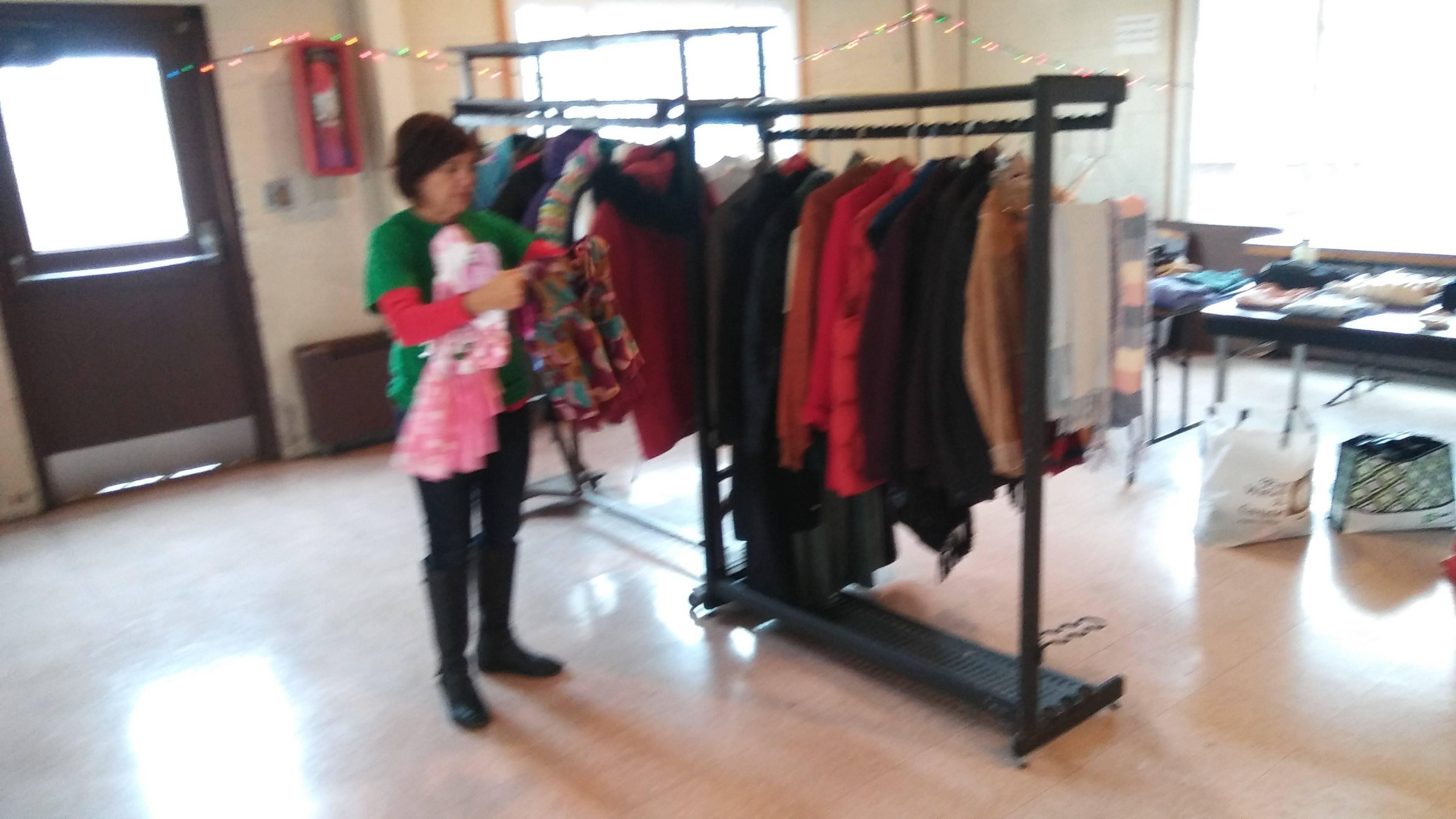 ce6a2417791363fb1820_Soup_kitchen_volunteer_Lynne_Fitzpatrick_sorting_through_clothing.jpg