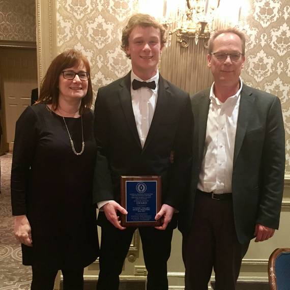 0161ba0be63011c726aa_754c30f725ed0dbfaba8_Tucker_Voelbel_with_parents_at_the_23rd_Annual_Scholar_Athlete_Awards_Dinner.jpg