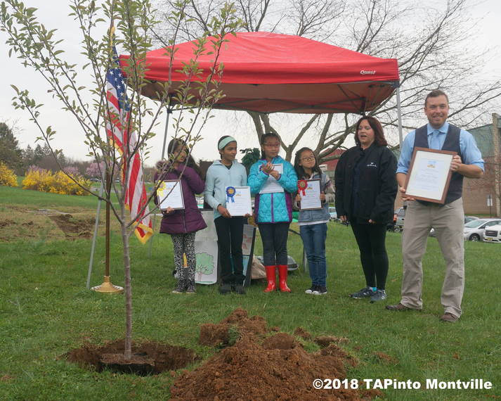 08e964fc6318caee56a7_a_Teacher_Paul_Rolfe_accepts_his_certificate__in_the_foreground_is_the_apple_tree_planted_in_his_name__2018_TAPinto_Montville.JPG