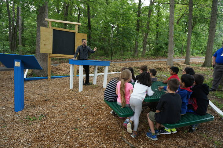 116e112acb22bacc7481_a_Teacher_Gregg_Milite_uses_the_outdoor_classroom_with_his_1st_grade_class.JPG