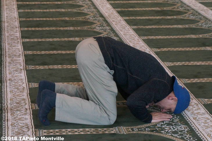 13dd20961080572c1194_a_Jam-E-Masjid_Islamic_Center_s_Gul_Khan_demonstrates_a_prayer_position__2018_TAPinto_Montville.JPG