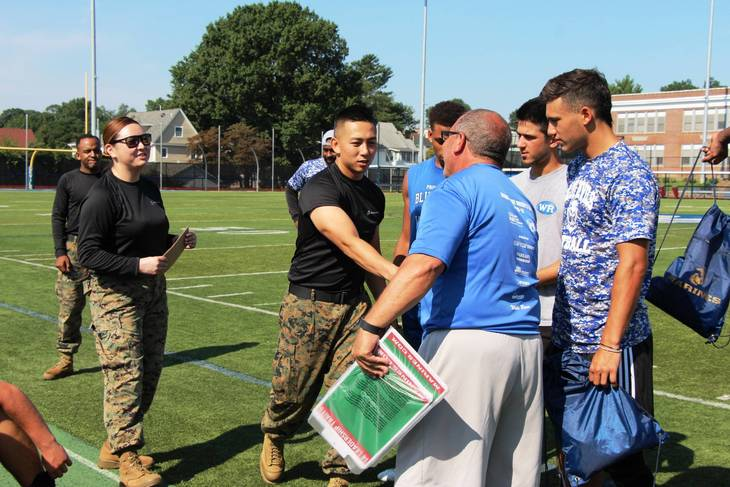 1755d2be3d54be606c47_EDIT_marines_and_Coach_T.jpg