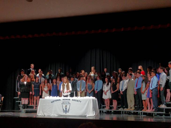 1a816f69d45c99319b6e_a_Viktoria_Olowski_lights_a_candle_at_the_NHS_induction_ceremony.jpg