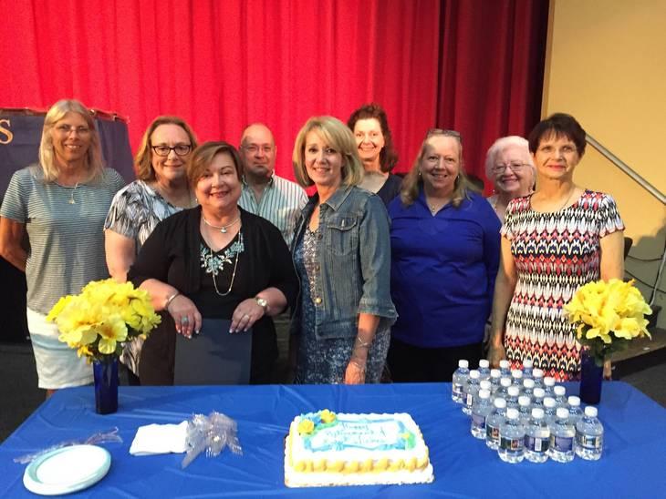 1a94f2b9190c0290a9f4_Retirees_and_Cake.JPG