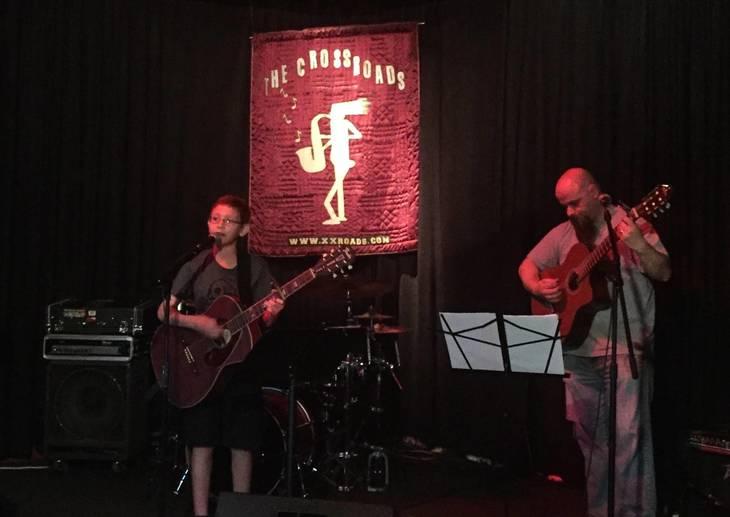 1bba797f239ba24c4270_Levine_5_-_Matt_playing_at_EEF_MusicFest_2016_with_guitar_teacher_Loren_C._Fortna.jpg