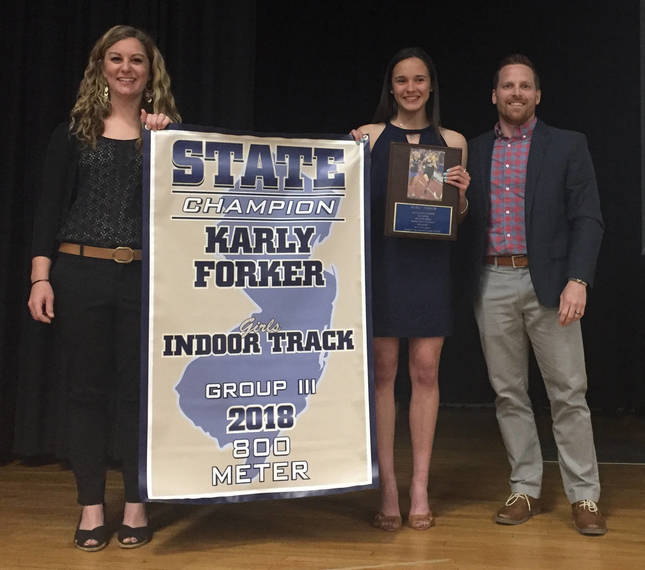 23085210b73945cd53e6_Coaches_Schmidt_and_Bischoff_with_Karly_Forker.JPG