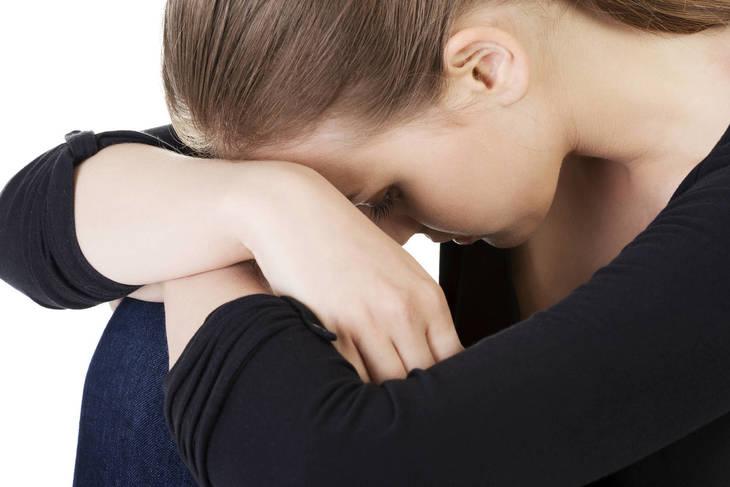 24b0cb215f969a45b5a5_bigstock-Sad-teen-girl-hunched-crying-46943326.jpg