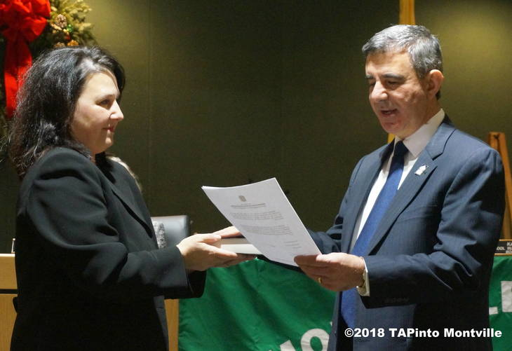 26d640b080ed4a0899bd_a_Re-elected_board_member_Michael_Palma_re-takes_the_oath_of_office_from_Katine_Slunt.JPG