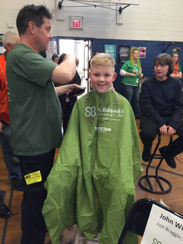 2d94b1c82c5daea7759f_Nathan_Byrne_prepares_to_have_his_head_shaved.JPG