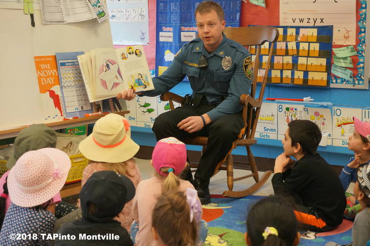 2e639101dc13309302aa_a_Montville_Township_Police_Officer_Scott_McGowan_reads_to_kindergarteners_at_Woodmont__2018_TAPinto_Montville_____1.JPG