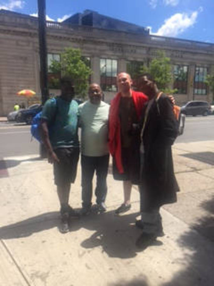 2f3d52ec57b4af7d870e_Photo_Caption__1_-_Rev._Gill_with_Gentlemen_at_Newark_Penn_Station.jpg