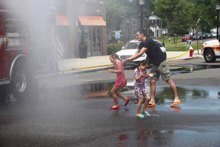 34431fbbda470bbe8fd3_EDIT_father_and_daughter_in_spray.jpg