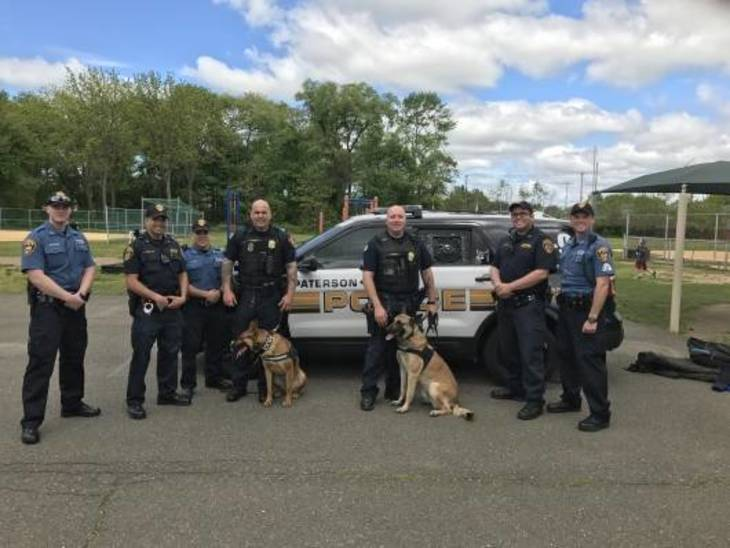 34a4a6e7be40a09822b1_K-9_with_Fairfield_Officers.jpg