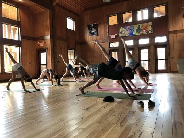 351b1d0865ac1c8961f1_Campers-Doing-Yoga.jpg