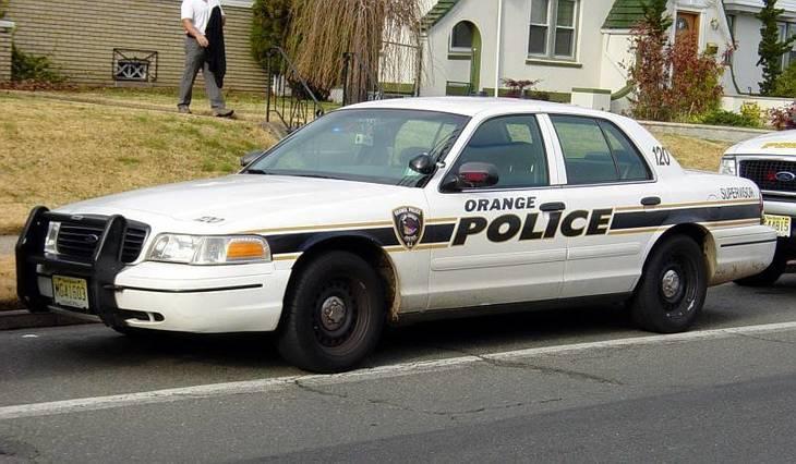 375e5463bae5c909af06_orange_police.jpg