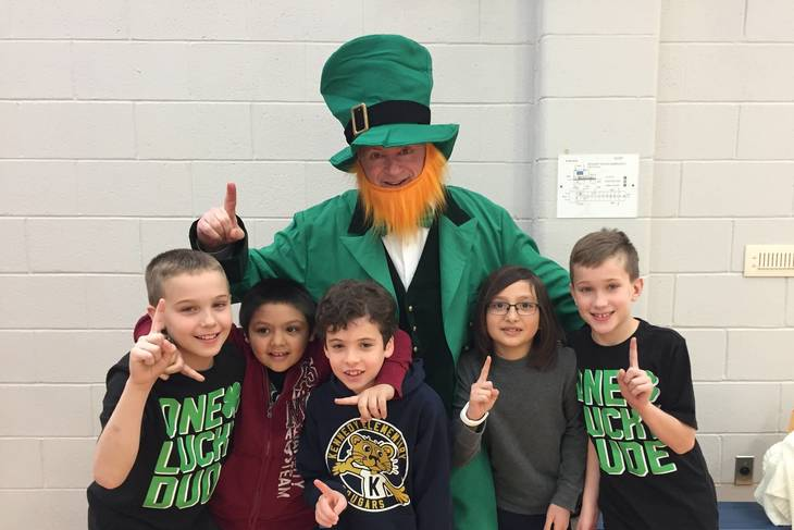 3a997315dd0ffab92596_4f51ab29285e3614bdd8_Kennedy_students_with_Leprechaun.JPG
