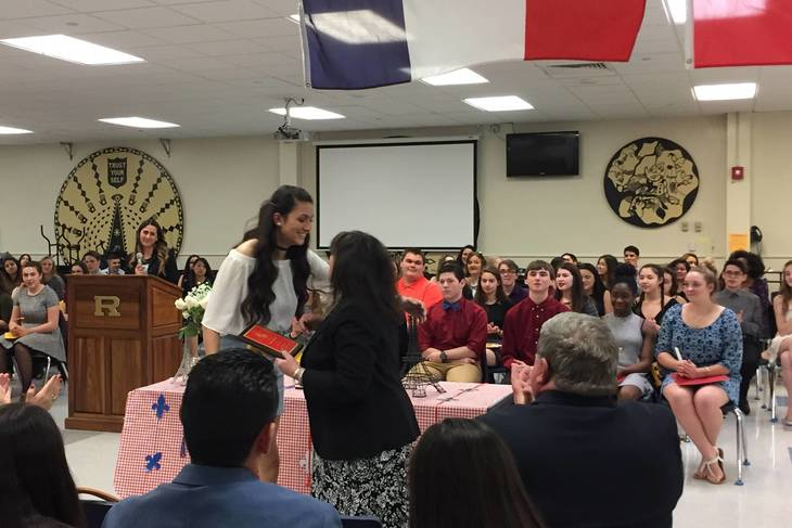 3b3ce5a87597c1f601cc_e78ecc8a56de9a4b99c4_Simonet_Presented_Plaque_by_Spanish_Honor_Society.jpg