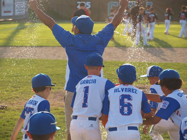 3b8442da8d77da883779_Coach_Lou_Aponte_gets_the_water_dumped_on_him.JPG