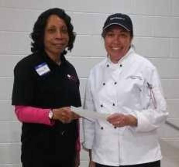 3d44365924168e584b41_FWC_Member_Nancy_Hargett_presents_donation_to_Promise_Culinary_School__New_Brunswick.jpg