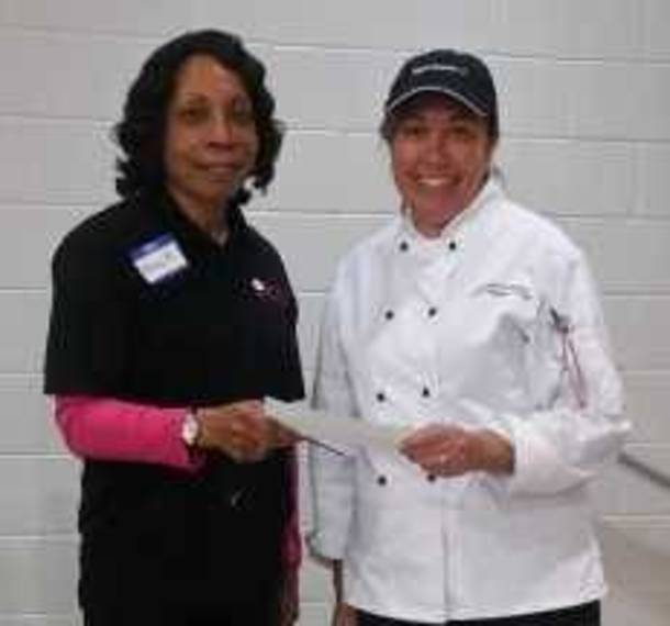 3d44365924168e584b41_FWC_Member_Nancy_Hargett_presents_donation_to_Promise_Culinary_School__New_Brunswick.jpg