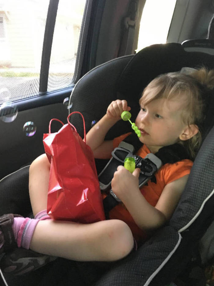 4274fe93b412cefe9513_blowing_bubbles_in_carseat_cropped.jpg
