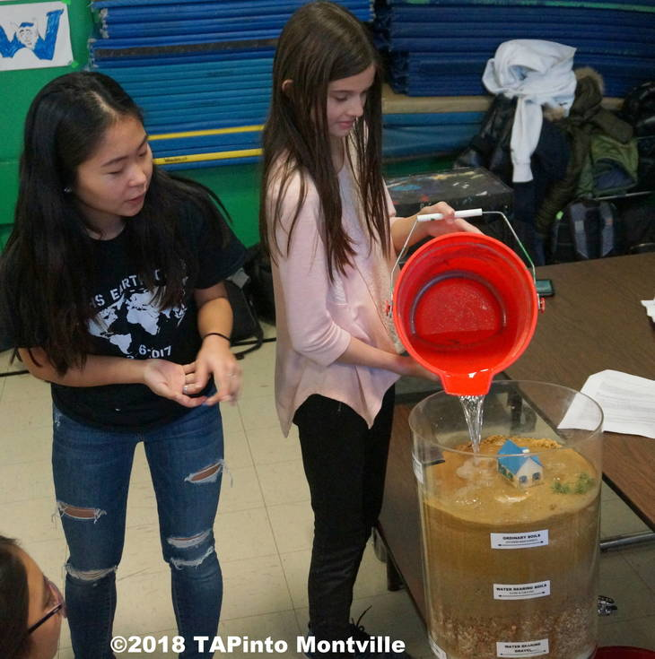 4319b5c832b35ec24f31_a_Fifth_grader_Nicolette_Arezzi_pours_water_into_the___Towaco_aquifer__MTHS_Earth_Club__2018_TAPinto_Montville____13.JPG