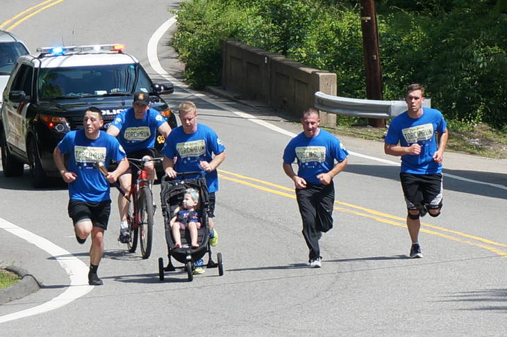 Law enforcement partner with Special Olympics athletes for Lima's first Torch Run