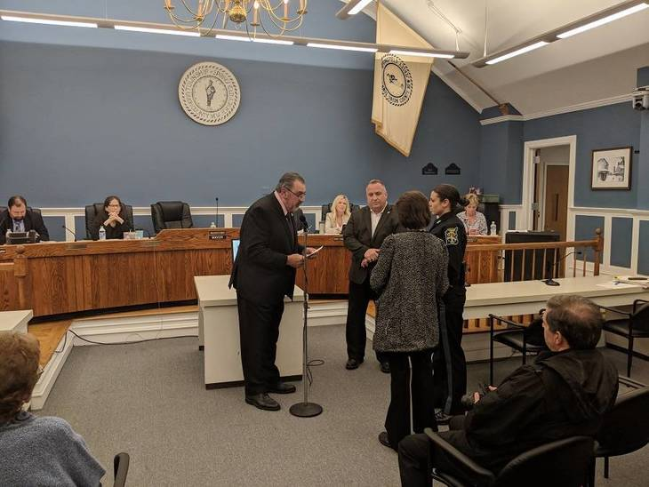 453fbb91f943c720ee67_Michelle_DiParisi_being_sworn_in_as_Probational_Patrol_Officer.jpg