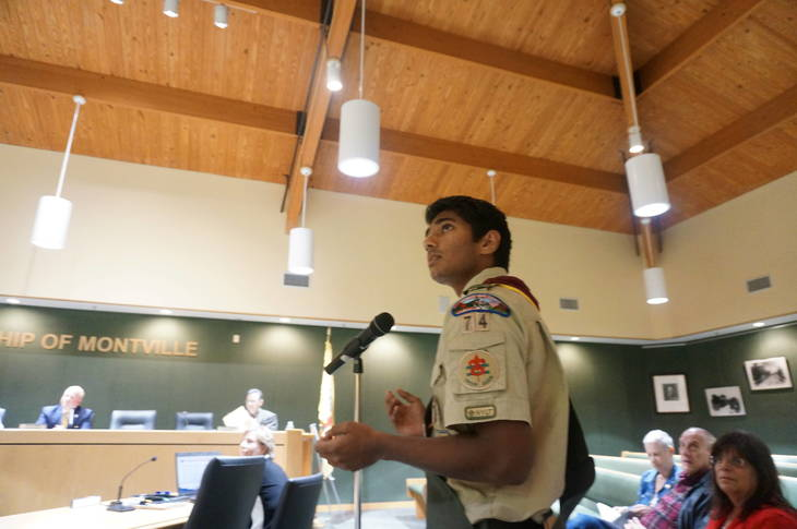4595710a33b1618e7878_a_Boy_Scout_Rahul_Menon_shows_a_presentation_about_his_proposed_Eagle_Scout_project_as_Sue_Goldblatt.JPG