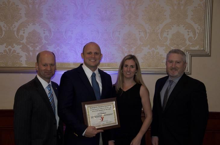 4652a3551421bbd0c123_Eric_Stoddard_receiving_award.jpg
