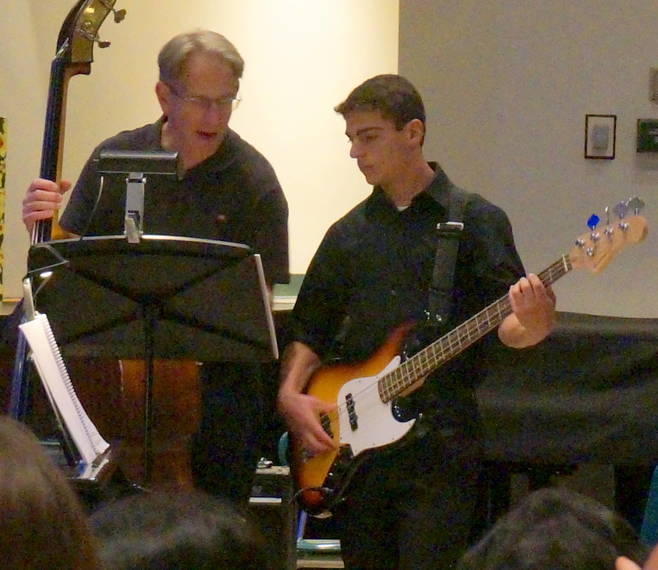 498682bac77adac7b724_a_Jonathan_Kraft_plays_electric_bass_with_Supervisor_of_the_Arts_Ed_Fleischman_in_May.JPG