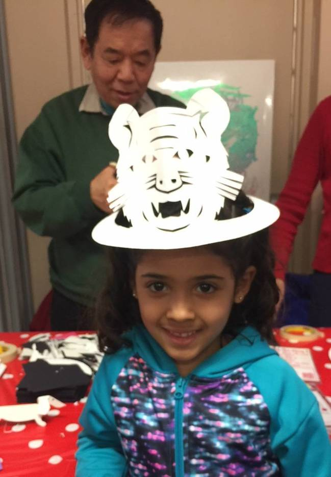 4a33970e3d49ae2f80b5_Little_Girl_with_tiger_paper_cutting.jpg