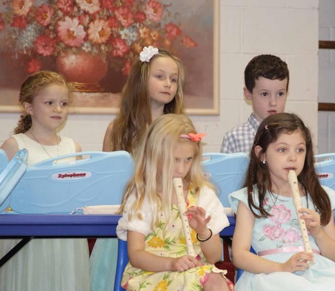 4b2e6fcf1293ab3c7cdd_Kindergarten_Grad_Children.jpg