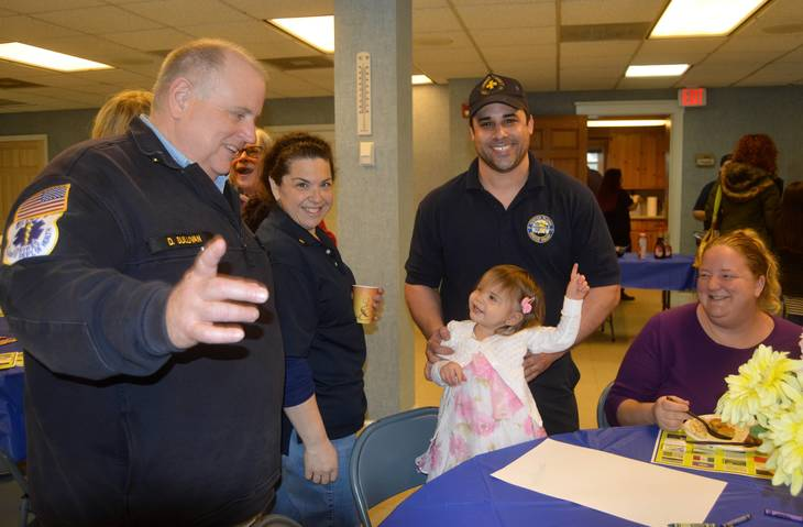 4e80f24dc9c09d5de7c9_Rescue_Squad_pancake_breakfast_Dan_and_little_girl.JPG