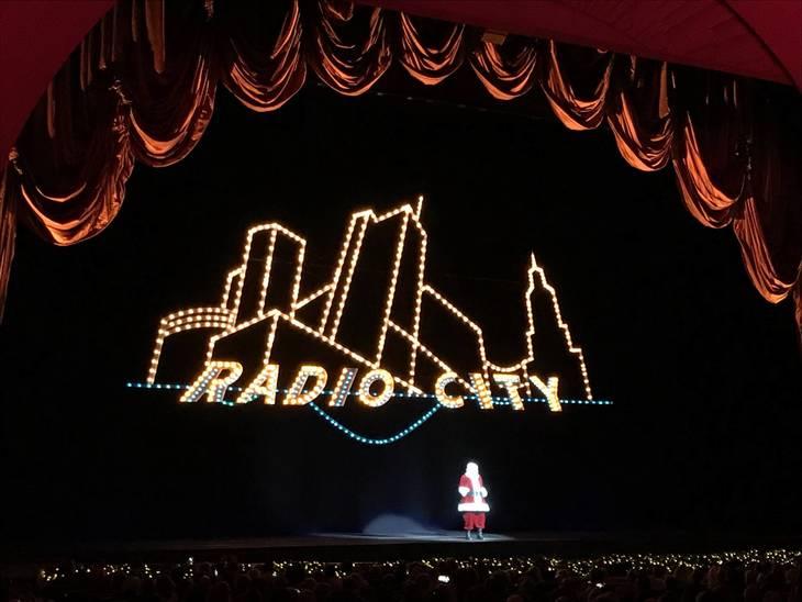 52daf30f653a6b1ddd70_TAP_-_Radio_City_-_Santa_on_Stage_.jpg