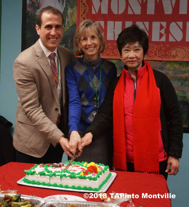 53a8bdc88e77d4bf96cd_a_Principal_Doug_Sanford__Superintendent_Ren__Rovtar_and_Chair_Margaret_Lam_cut_a_cake_at_the_luncheon__2018_TAPinto_Montville.JPG