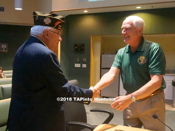 5408866cf5554c1983ad_a_New_commander_of_VFW_Post_5481_Andy_Vyniski_shakes_Mayor_Conklin_s_hand_after_presenting_himself_to_the_township_committee__2018_TAPinto_Montville.JPG