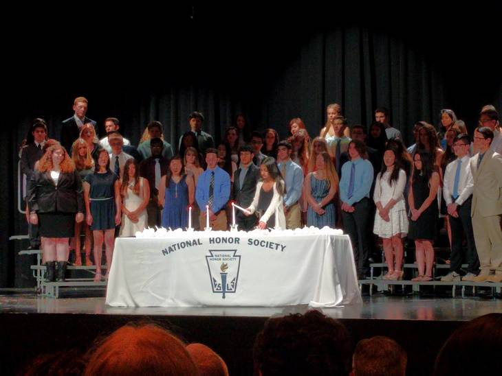555e870bfb3d3c5f54a5_a_Arushi_Gupta_lights_a_candle_at_the_NHS_induction_ceremony.jpg