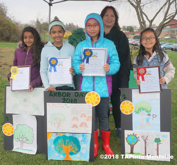 5904cb1147b3e3326b53_a_Four_of_the_six_poster_contest_winners_pose_with_Michele_Caron__2018_TAPinto_Montville.JPG