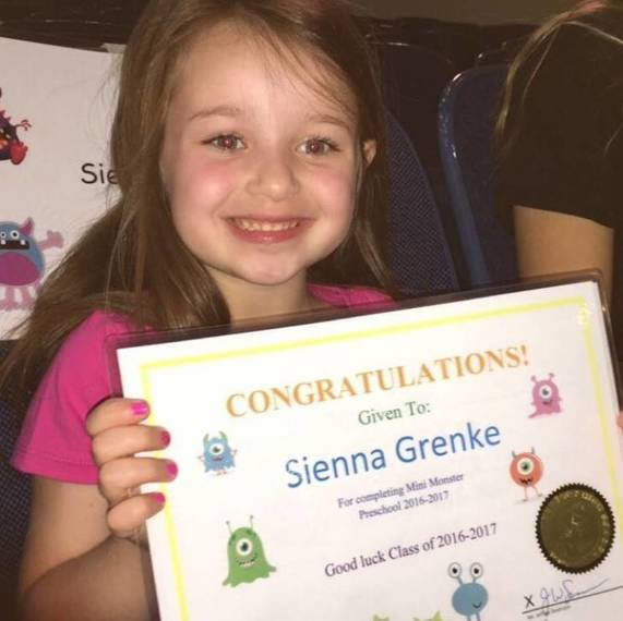 5a0a5a7543c63c4fc4f8_0f0422b36b448d75d5e7_Sienna_Grenke_with_her_RHS_preschool_diploma_on_Graduation_Day_____.JPG