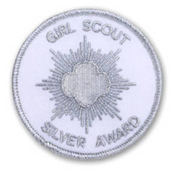 5c1141ca77a286ad925c_girl_scout_silver_award.jpg