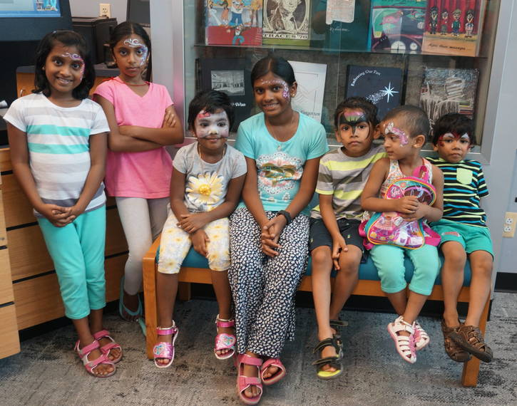 5e70913b82c81b26090c_a_Kids_show_off_their_face_painting_at_the_Montville_Twp_Library_Summer_Reading_Program_Finale.JPG