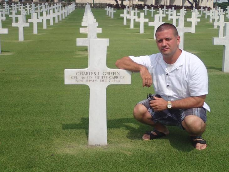 624c7fb0b31cdec2f3ec_Drew_at_Uncle_Charlie_s_grave.jpg